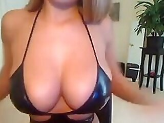 Camslut in tight leather displays her huge natural tits and ass video